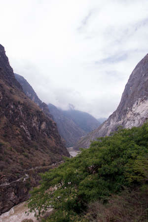 Cloudy day mountain Yangtze river in Yunnan Province, China