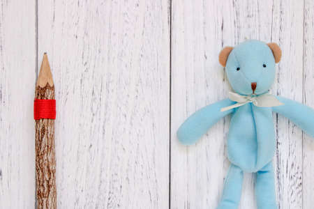 Stock Photography flat lay vintage white painted wood table blue bear doll pencil