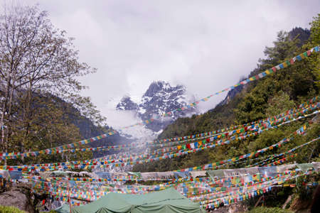 Meili snow Mountain also know as Kawa Karpo located in Yunnan Province, China decorated with colorful prayer flag 写真素材