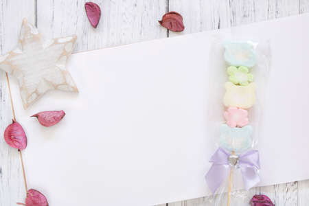 Stock Photography flat lay vintage white painted wood table note book paper flower petals cotton candy star craft 写真素材