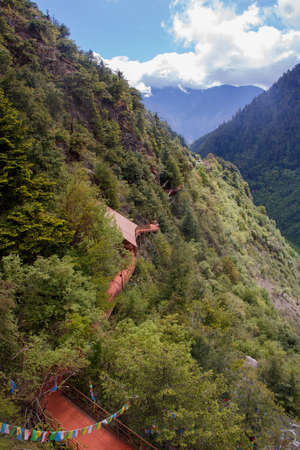 Mountain climbing trail sunny day landscape in Shangri La, Yunnan Province, China 写真素材