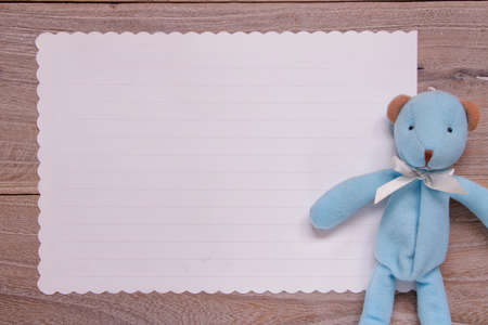Stock photography flat lay template wooden plank table white letter paper blue bear doll