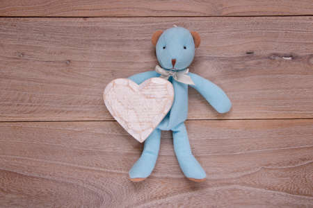 Stock photography flat lay plank table template blue bear doll holding heart craft 写真素材