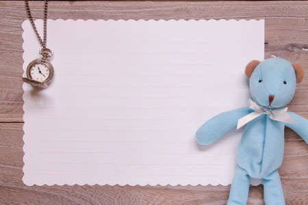 Stock photography flat lay template wooden plank table white letter paper blue bear doll pocket clock 写真素材