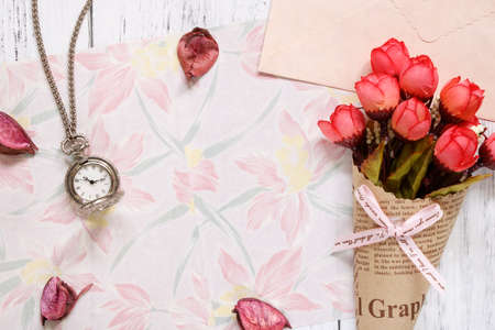 Flat lay stock photography flower pattern message letter paper rose petals pocket clock