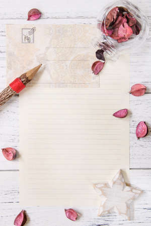 Flat lay stock photography purple flower petals letter envelope paper glass bottle wood pencil star craft 写真素材