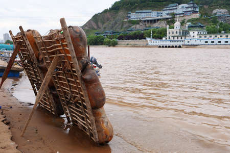 Sheepskin raft by the Yellow River in Lanzhou Gansu China 版權商用圖片
