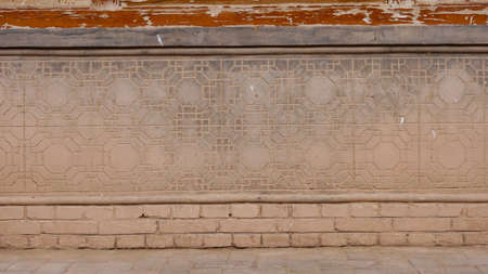 Anceint traditional retro Chinese architecture residential house brick wall in Gansu China. Imagens
