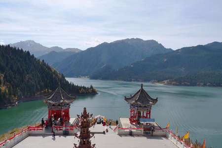 Nature landscape view Heaven Lake of Celestial Mountains and Taoist Heavenly Queen Mother temple in Xinjiang China. 写真素材