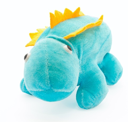 velours: The toy of the little charming dragon at the white background