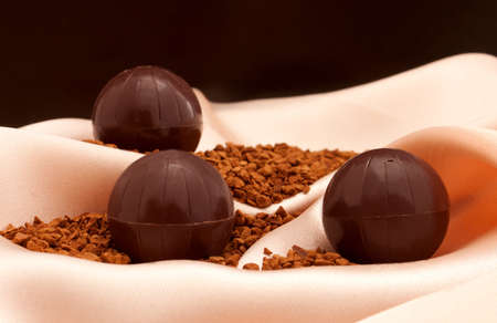 The still life with chocolate  ball-form candies  photo