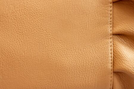 a frill: Leather beige background with the frill close-up Stock Photo