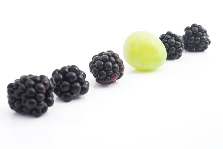 distinguish: The row with blackberries and a green grape Stock Photo