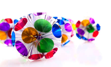 Round shape Christmas decoration made from the multicolored foil photo