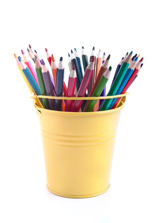 The set of varicoloured pencils in the yellow pail  photo