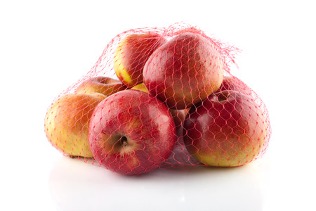 apple sack: The heap of apples packaged in the red net