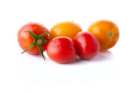 The heap of red and yellow tomatoes, isolated photo