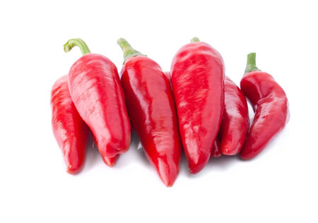 poignant: Accurate Heap of Hot Red Peppers, Isolated on White