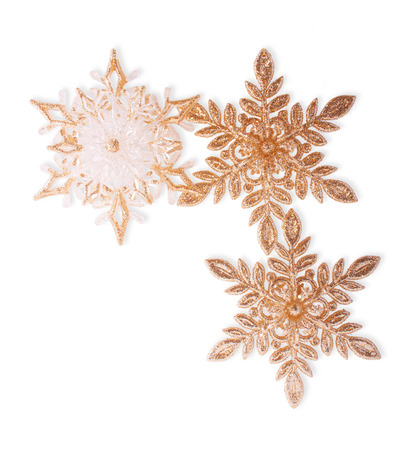 Three Christmas Golden Snowflakes, Isolated on White photo