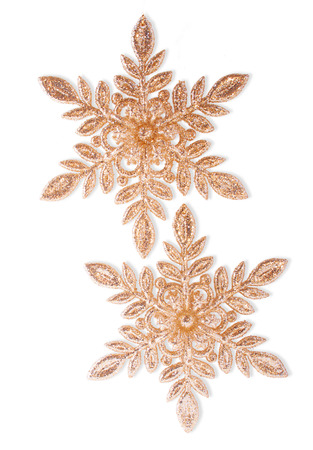 Two Golden Glittering Snowflakes, Isolated on White photo