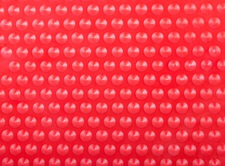 knoll: Plastic Red Background with Many Cone Round Dots Lighted as Radar