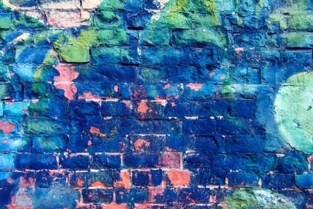 fragments: Colorful Weathered and messy Brick Wall with Bright Blue Graffiti Fragments Stock Photo