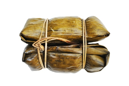 The dry banana leaf is on the white background photo