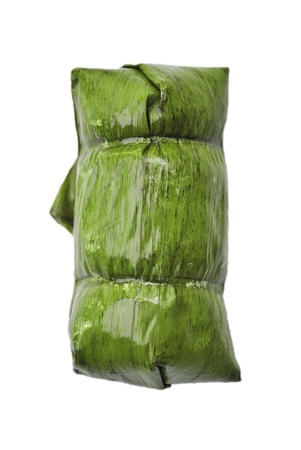 The fresh banana leaf is on the white background photo