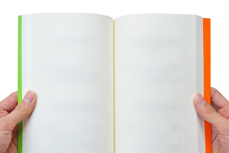 The hand is opening the book that on the white background