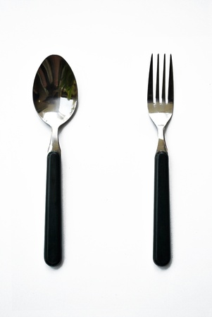 The aluminium spoon and fork are on the white background Stock Photo - 9261537