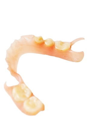 The false teeth is on the white background Stock Photo