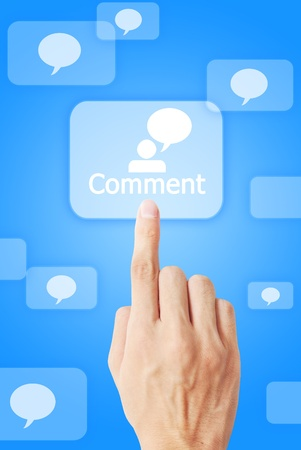 The hand is pressing the comment button Stock Photo - 9579614