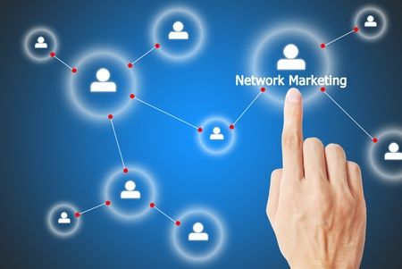 media event: The hand is pressing the button the network marketing Stock Photo