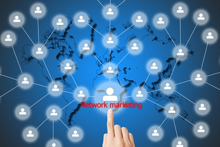 The hand is pressing the button network marketing