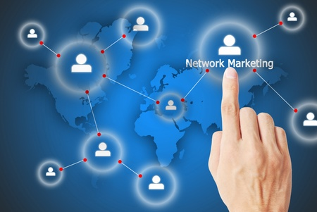 The hand is pressing the button network marketing photo