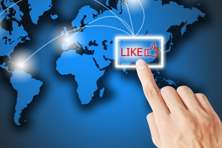 The hand is pressing the like button Stock Photo - 9626246