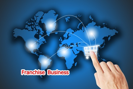 The hand pressing on the retail button franchise business photo
