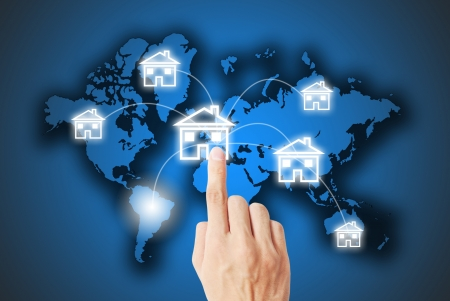 worldwide website: The hand pressing on the real estate button