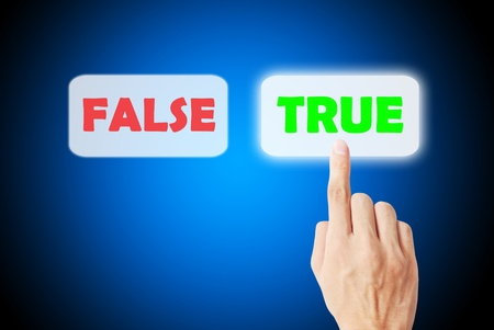Finger is pressing on the true and false statements photo