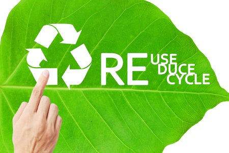 Finger is pressing on the recycle symbol Stock Photo