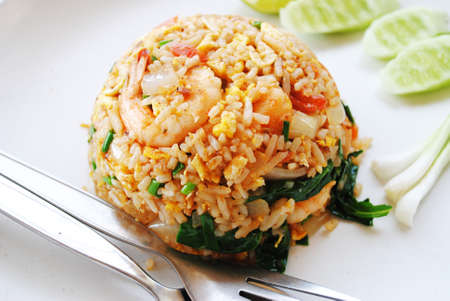 Fried rice with pork is on the dish photo