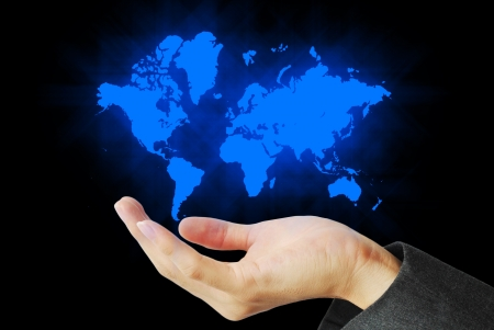 world connectivity: The world map is float on the hand Stock Photo