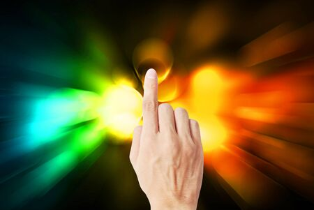 pause button: The hand touch the beautiful rainbow light