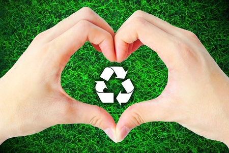 The hand heart and recycle sign is on the white background