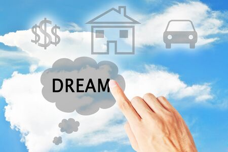The hand is pressing the dream that on the cloudy sky Stock Photo - 9974169