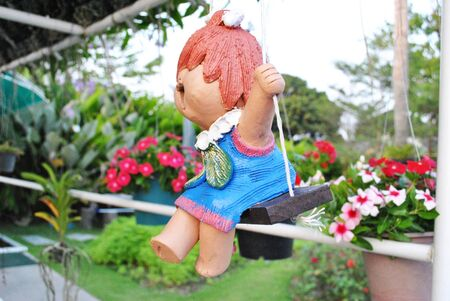 Home made ceramic doll is hang on photo