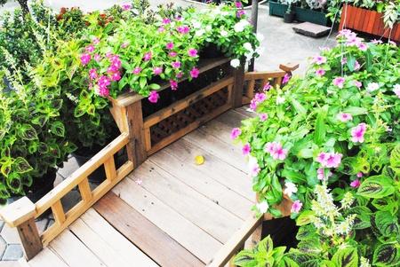 woden: The artificial wooden bridge is in the garden            The artificial woden bridge is in the garden