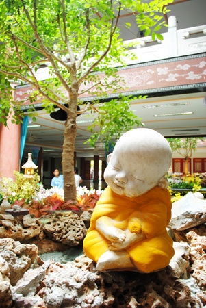 3rd ancient: Sleep little monk statue is in thai temple