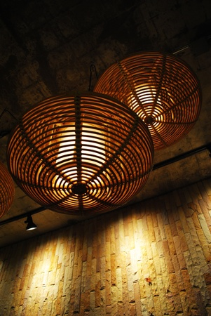 The ancient bamboo lamp is in the room photo