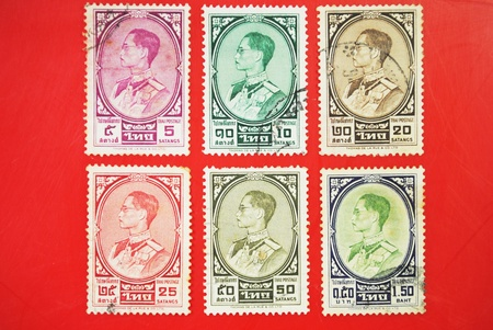 THAILAND - CIRCA 1950: A stamp printed in USA shows image portrait Bhumibol Adulyadej (Royal Institute: Phumiphon Adunyadet born 5 December 1927) is the current King of Thailand, circa 1950.  photo